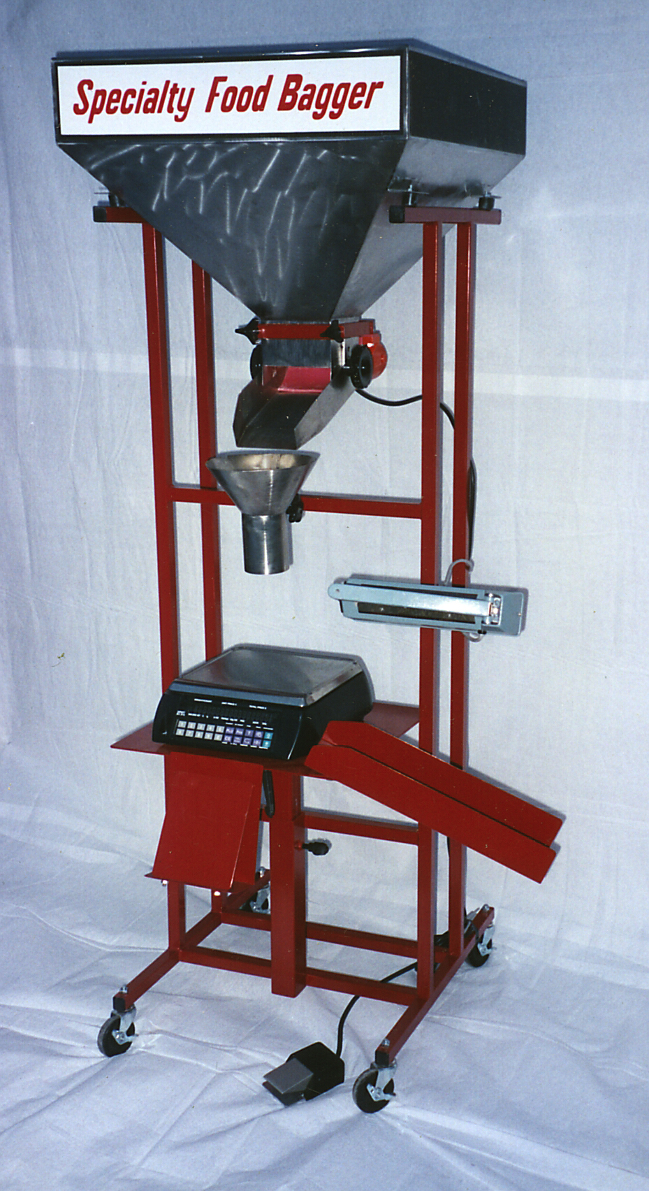 "The first ""Specialty Food Bagger"" with off-the-shelf scale and heat sealer"