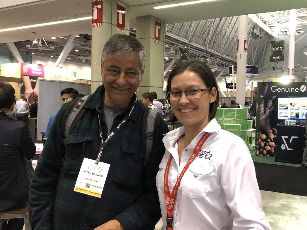 Jairo Blanco of Logical Machines' new coffee friend, Teresita Jara of Café de Costa Rica, during the 2019 Specialty Coffee Expo in Boston