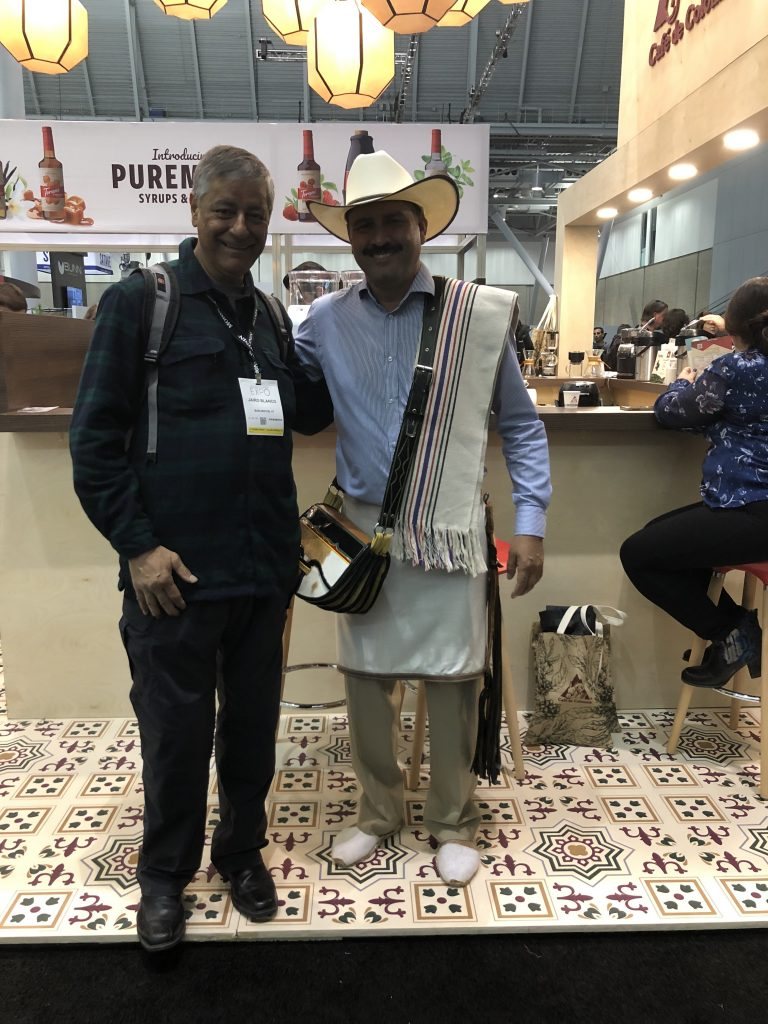 Jairo Blanco of Logical Machines getting some brewing tips from Juan Valdez in the Café de Colombia booth during the 2019 Specialty Coffee Expo in Boston